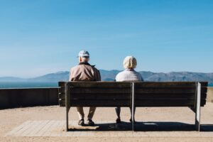 old people sitting on a bench